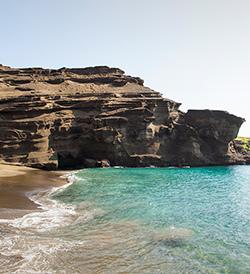 Cliffs face at green sand beach