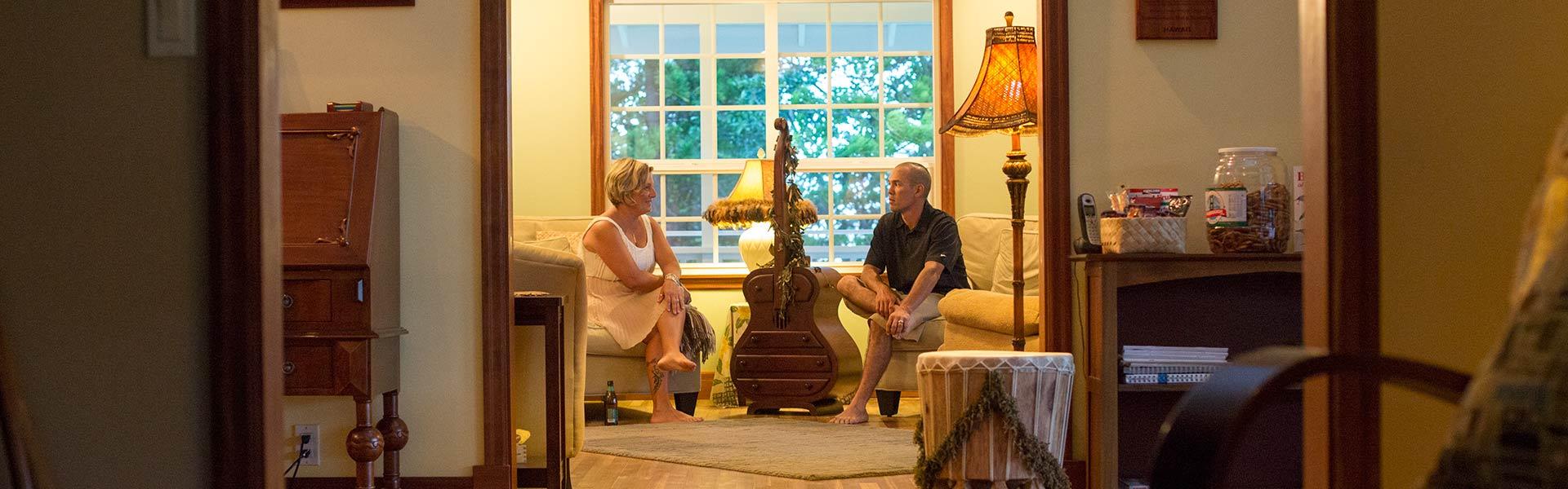 Couple relaxing in the parlor at Kalaekilohana Inn & Retreat