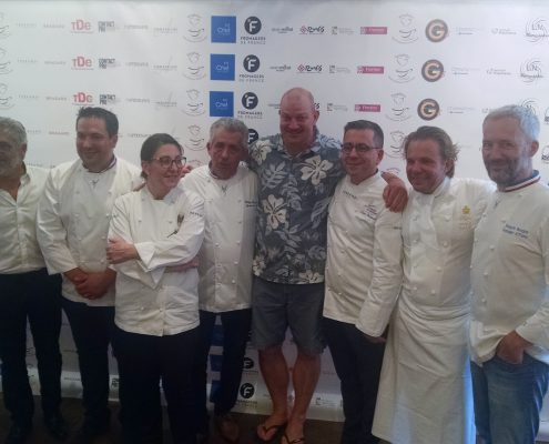 Chef Kenny in his Aloha attire flanked by seven of France's respected Chef's and Food Experts.